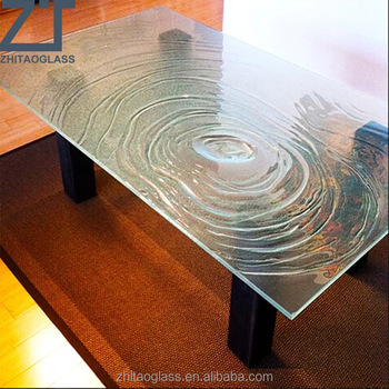 distinctive water ripples cast glass table