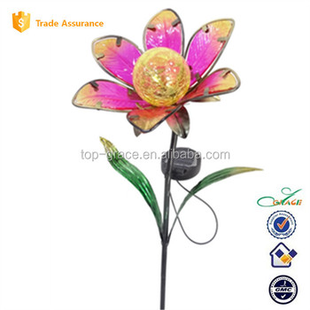 Metal Flowers And Garden Stakes With Solar Light