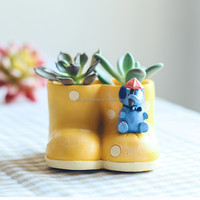 2017 wholesale winter resin snow boot yellow shoe shape home &amp garden resin flower pot made in China