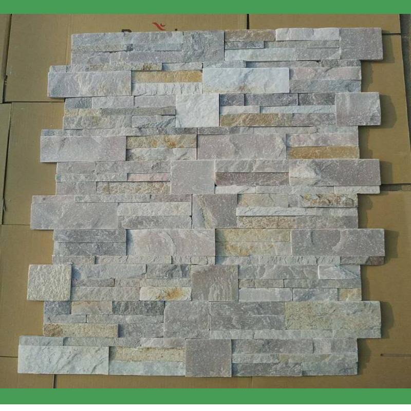 Fachada de muro de piedra de pizarra amarillo azulejos for Fachadas con azulejo