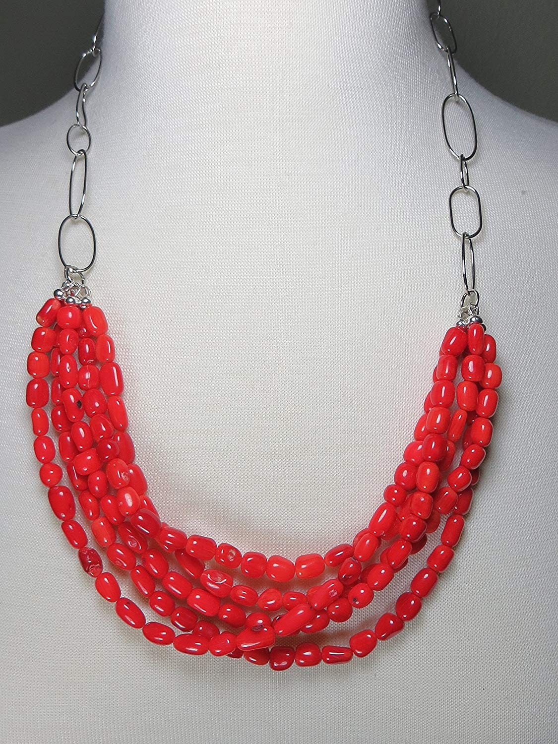 Multi Strand, layered bamboo coral freeform tube statement necklace with chunky silver plated large loop chain. Hook clasp closure