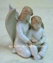 resin sculpture of two angels