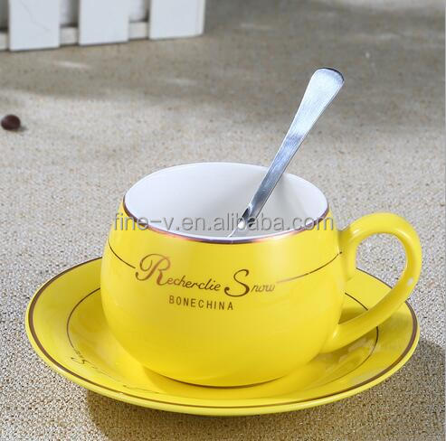 Yellow ceramic tea cup with platter, Coffee cups with ceramic spoon