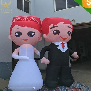cute inflatable groom and the bride character for wedding decoration