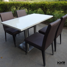 absolutely black artificial marble dining table with 4 seaters chairs