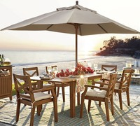 chairs and tables beach umbrellas wood pole