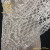 Heavy embroidered corded lace fabric with sequins