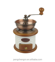 Household ceramic and wood hand coffee grinder
