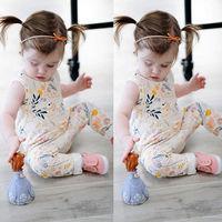 new fashion design organic cotton baby pom pom romper apparel