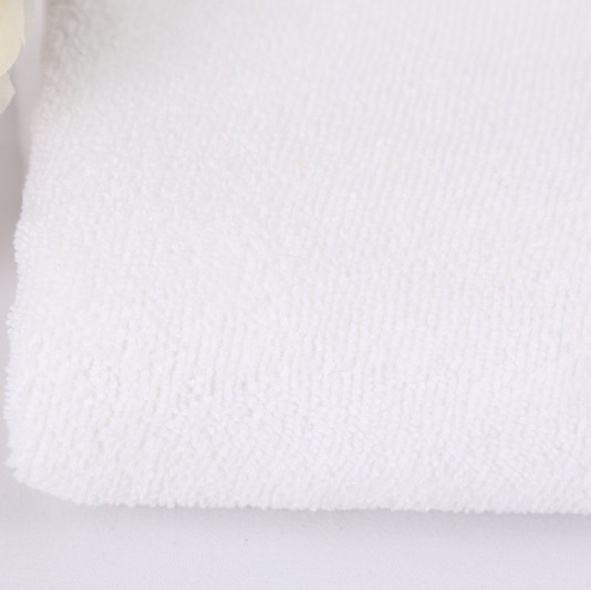stock high quality 100% polyester warp super white beach towel <strong>fabric</strong>