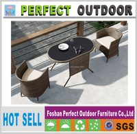 Outdoor rattan oval dining table and chairs patio furniture