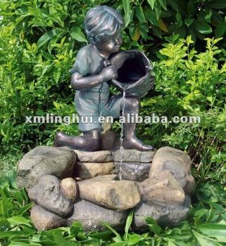 Pond statue of boy peeing