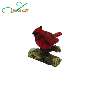Resin bird Cardinal on log Christmas Decoration