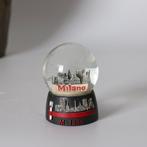 modern city Milano building snow globe with blowing snow