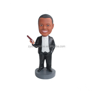 Custom wholesale personalized dashboard cartoon resin body funny figurines craft dolls talking black bobbleheads for cars
