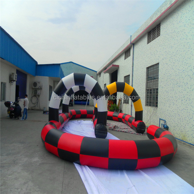 2019 hot selling Inflatable race track zorb ball racing jump horse game go kart gonfiabile tunnel scivolo
