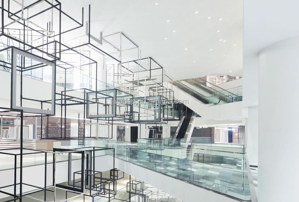Warenhuis interieur ontwerp kleding handtas schoenen retail winkel