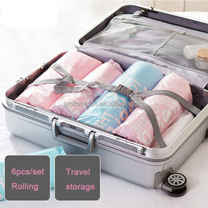 Hand pressing travelling vacuum compression bag roll up storage bag