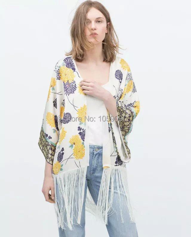 Compra chaqueta kimono fringe online al por mayor de China
