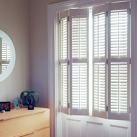 White UV painted Basswood and PVC Plantation Shutters