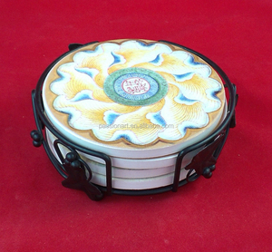 beautifully decorated ceramic drink coasters set with a decorative metal holder
