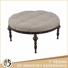 features geometric design Wood legs Upholstered round Ottoman