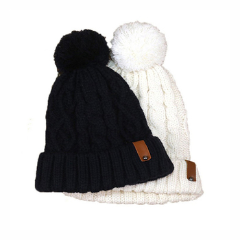 Black and white leather label knitted custom beanie hat with top ball f4445bc9248