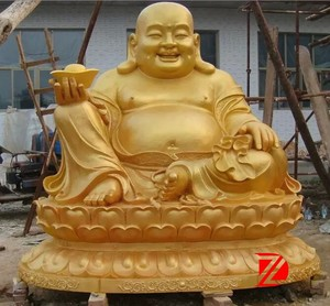 gold laughting buddha statues with gold ingot