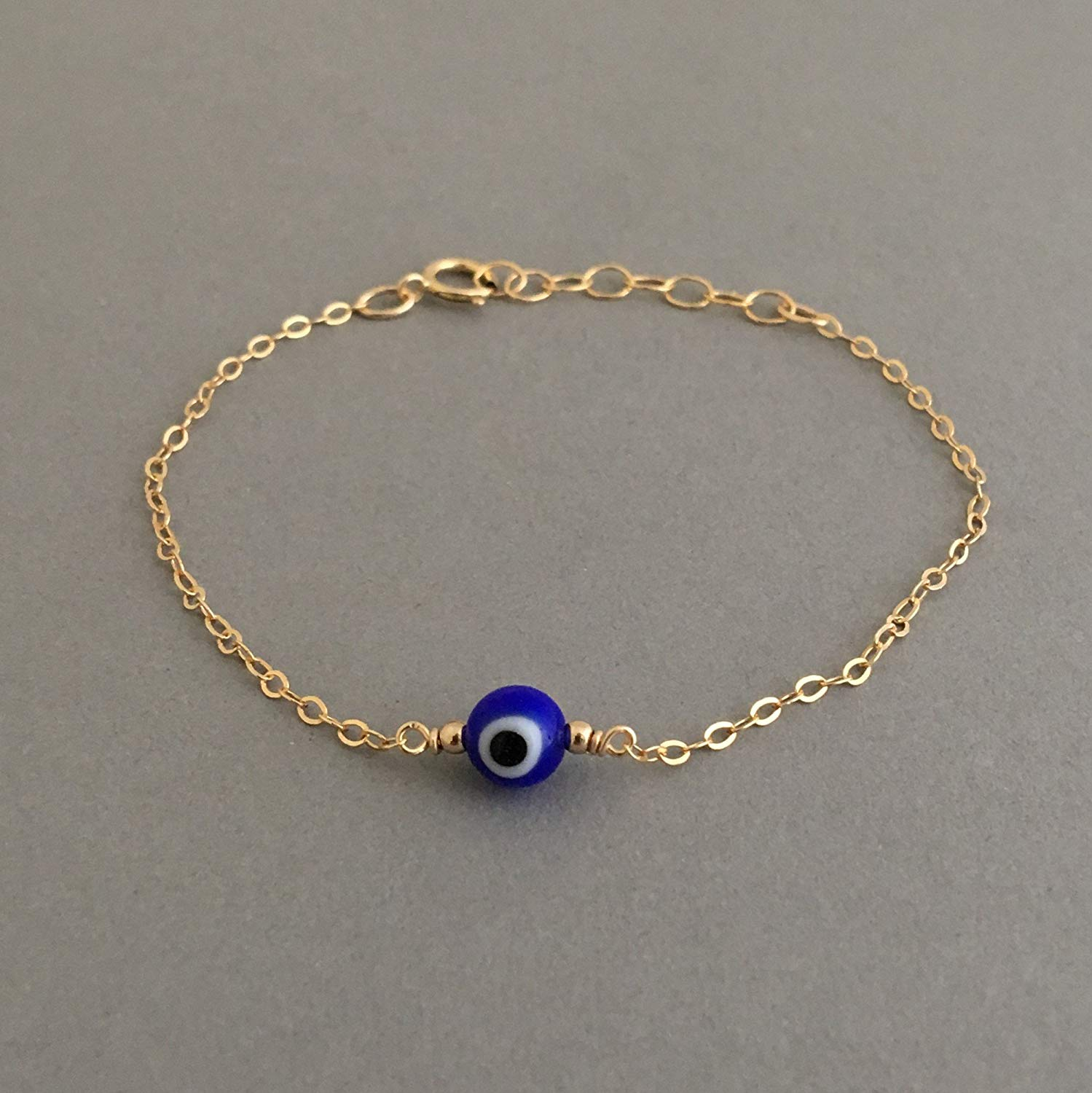 Round Blue Evil Eye Bracelet available in gold and silver