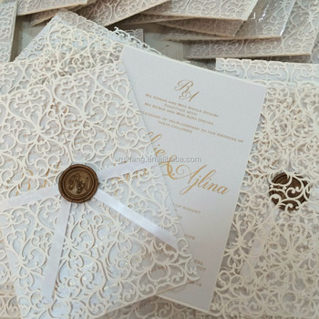 big gatefold lasercut wedding invitations with ribbon and wax seal