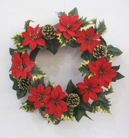 A Christmas wreath decorated with large red flowers