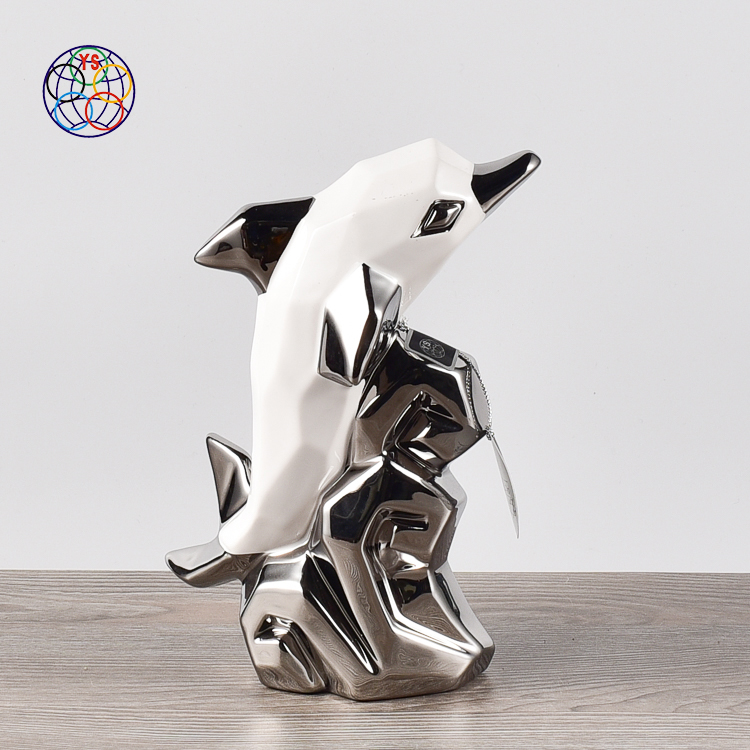 Fancy design ceramic hand curved dolphin ornaments luxury show pieces for home decoration