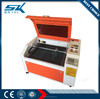 mini laser engraving machine with low price for glass sheet plastic wood MDF Furniture decoration fabric 600*900mm