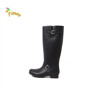 long black custom rubber boots with metal buckle