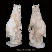 Hand carved red marble bear statue