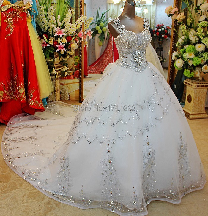 a25ab0f3d251 Top Fashion 2015 Luxury Sparkly Crystal Beaded Bridal Wedding Dresses With Long  Train Lace Up Spaghetti Strap Wedding Dress