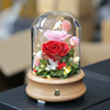 yarn ball red rose in glass dome