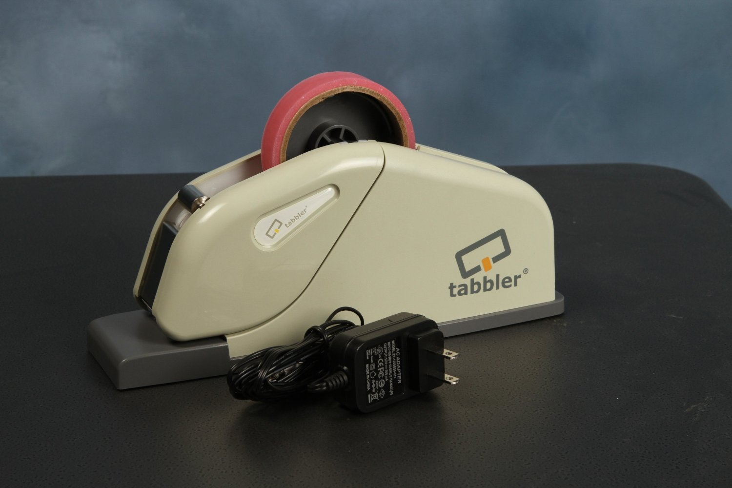 Dynafold TB-100 Tabbler Tabbing Machine, Places a strip of tape on the open edge of folded self-mailers, Ideal for small volume businesses and non-profits that hand-tab mailers and brochures, Affordable and easy to use semi-automated solution for tabbing, Designed to fit on an office Desktop, About