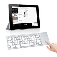 Factory price slim portable mini folding foldable bluetooth keyboard with trackpad