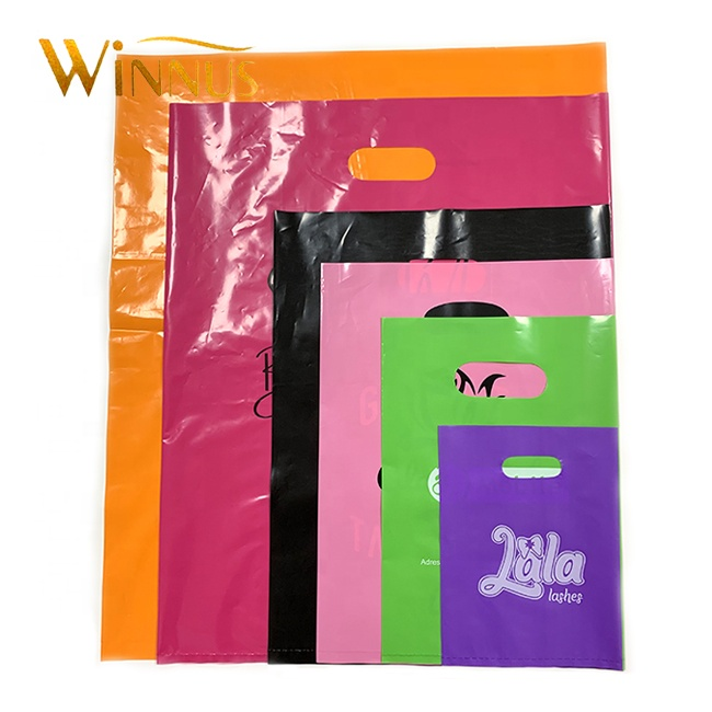 guangzhou cheap printing die cut handle cute garment plastic bags with logo for clothes shopping