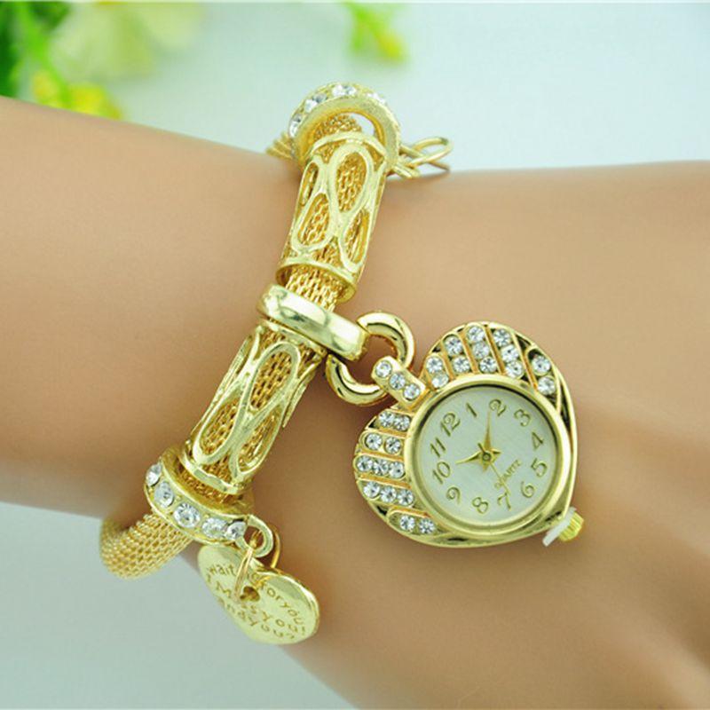 e0fa35fc0a3c Oro plata mujer exquisita pulsera de forma de corazón de cuarzo relojes de  pulsera de aleación