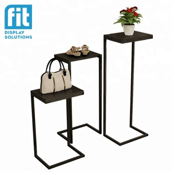 Modern 3 pieces set side table 3 black metal retail display risers for various height shoes bags garments and accessories stand