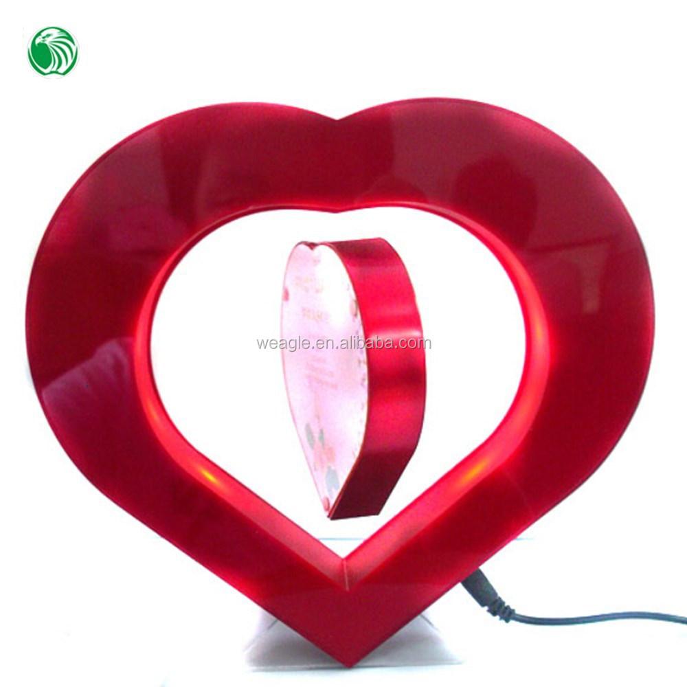 Dos lados en forma de corazón marco de fotos de levitación magnética ...
