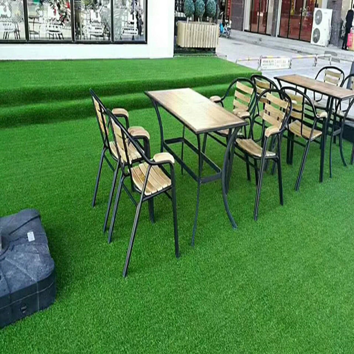 Beautiful landscaping green artificial grass in garden/park,hot grass