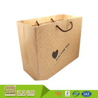 Cheap Brown Cmyk Printing Heart Pattern Unique Virgin Custom Handmade Shopping Kraft Paper Bag Manufacturer In China