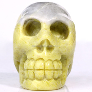 Wholesale rock crystal carving crafts semi-precious stone yellow lemon jade skull