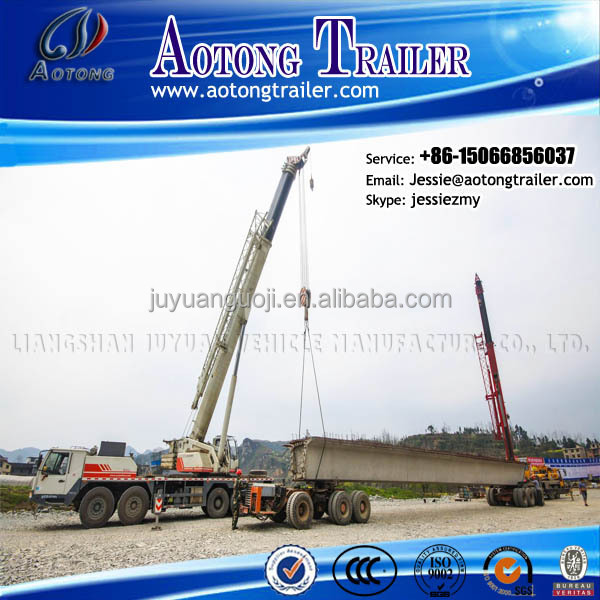 heavy duty bridge transportation trailer with rotary axis and hydraulic steering wheel