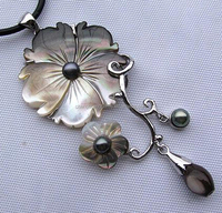 carved black/grey mother of pearl shell flower for pendant
