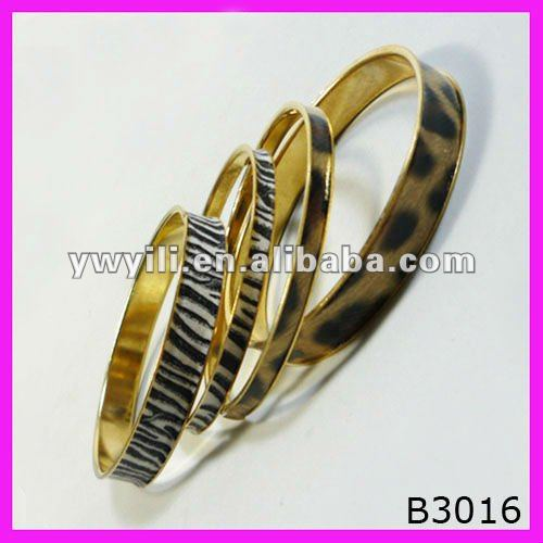 Gold plated delicate zebra printed bangle