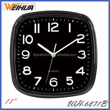backwards running black frame wall clock with black face